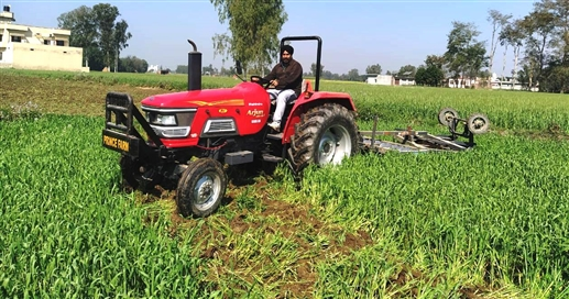 Tractor plowing of wheat crop in protest of agricultural laws