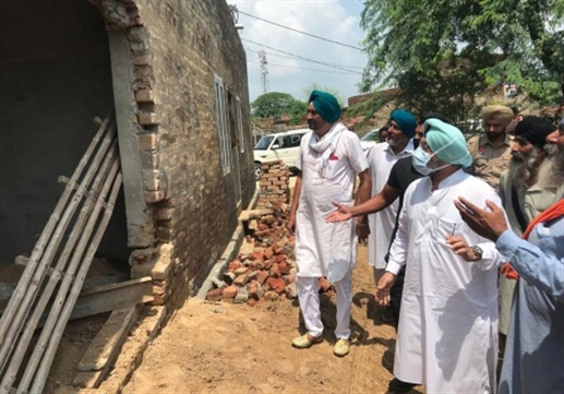 Former MLA Sidhu reviews rain-damaged houses, seeks financial assistance