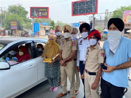 Newborn couples returning from hospitals receive warm welcome Moga Police distributes laddu on the spot