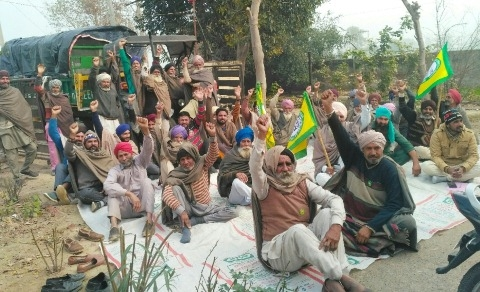 farmer protest front of light grid