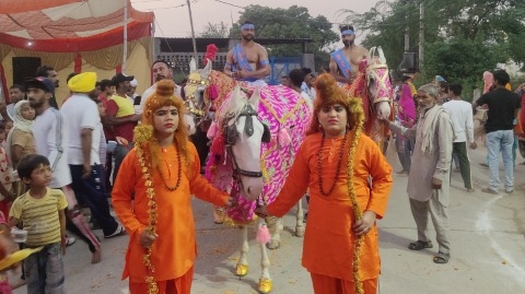A grand procession in connection with the Revelation Day of Lord Valmiki at Sheikhupura