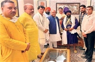 Nihang Baba Aman Singh photos with BJP leaders went viral in the state