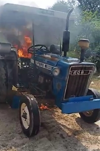 Farmers burn tractors in protest of agriculture bills