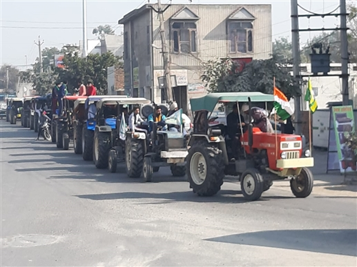 Farmers stage a tractor march in Muktsar to protest against agricultural laws