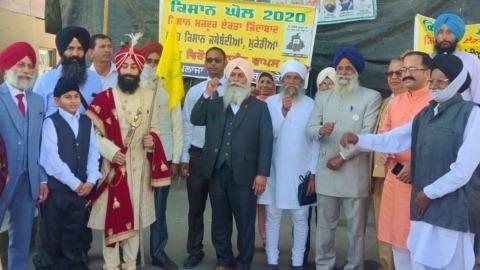 Bridegroom left with Farmers Flag